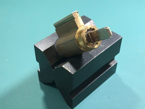 Tailpiece orientation on a key-in-lever cylinder.
